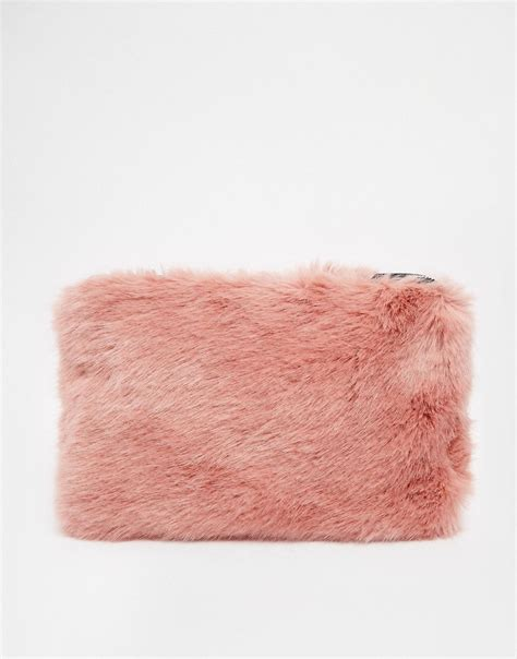 Faux Fur Clutch pink whistles faux fur clutch in pink at asos