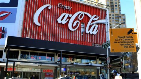 Sues Background Check Site Coca Cola S Iconic Neon Billboard Is About To Be Put Up For Auction