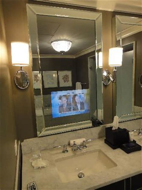 neat tv behind the bathroom mirror picture of waldorf
