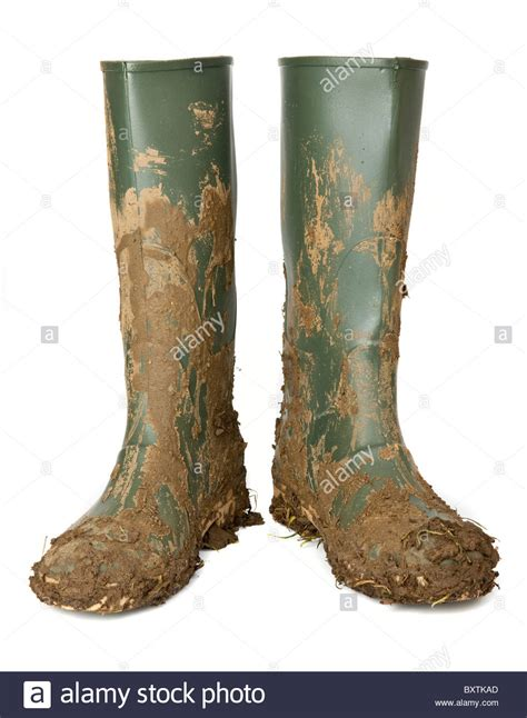 muddy boots muddy wellington boots stock photo royalty free image