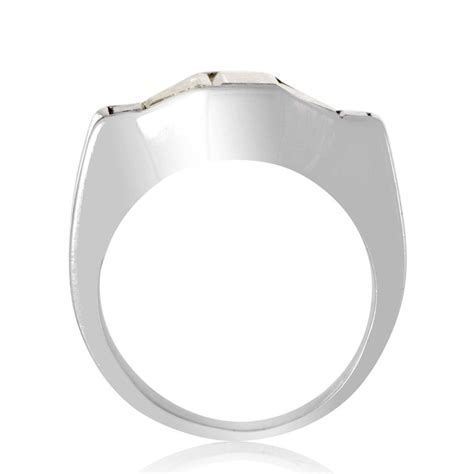 emerald and trapezoid cut bezel set platinum ring