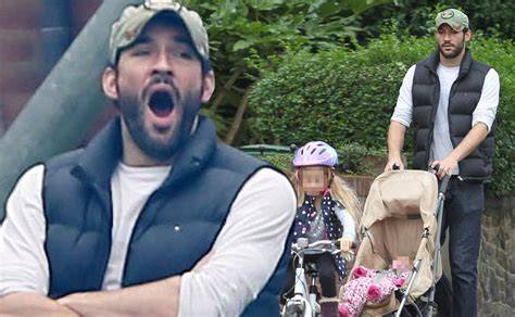 His leading ladies: Tom Ellis spends quality time with his daughters during a family trip to the