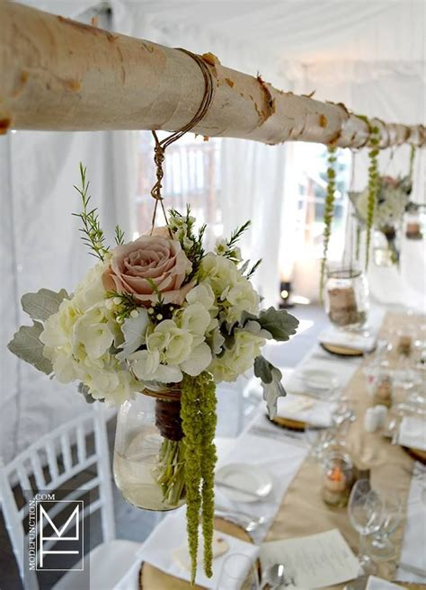 25 best ideas about hanging flower arrangements on wedding flower arrangements