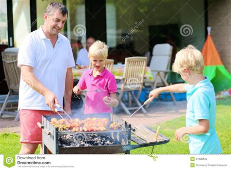 with sons grilling in the garden stock photo