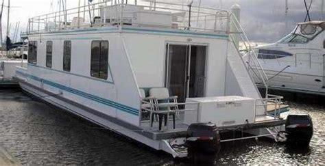living on a boat vs house are catamaran houseboats a pontoon cruiser or a house boat