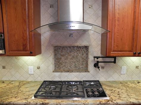 kitchens pot filler tumbled linear stone tiles a tumbled marble kitchen backsplash with a recessed niche