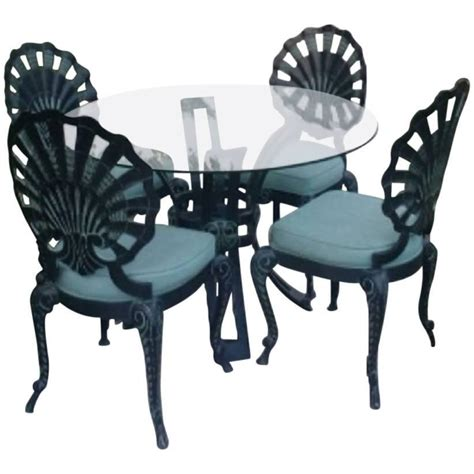 brown five grotto shell back metal dining