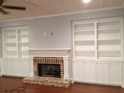 custom arts and crafts fireplace mantel and side bookcases