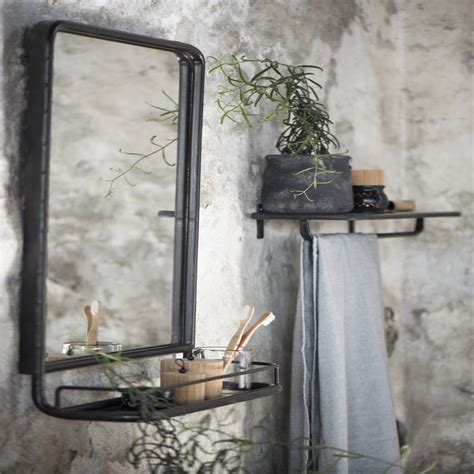 large industrial wall mirror with mini shelf by the forest
