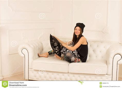 having on couch young woman on a sofa royalty free stock photo image