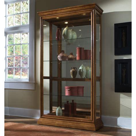 pulaski golden oak   sliding door curio cabinet