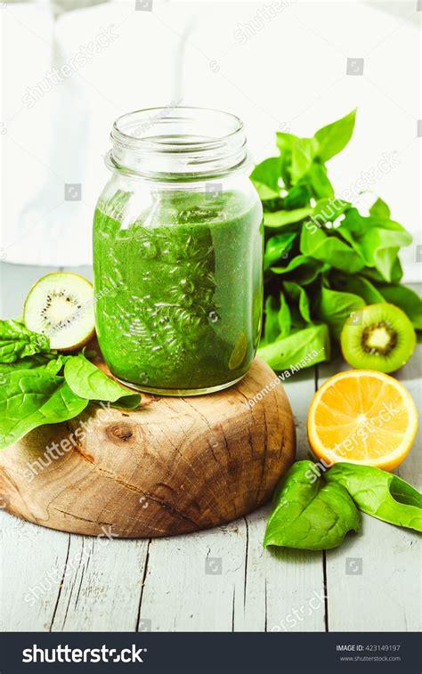 Kiwi Detox Smoothie by Green Smoothie Spinach Kiwi Citrus Summer Stock Photo