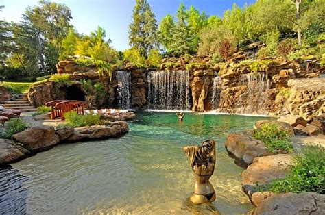 Decorating Guest Bedroom naturalistic pools with grotto tropical pool los