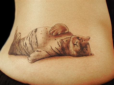 cute tiger tattoo designs grey ink sleeping tiger on lowerback