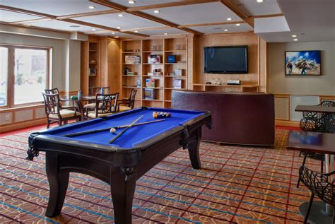 a game room for adult that will make your leisure time viana hotel spa bw premier collection westbury new