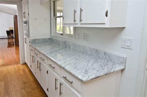 Kitchen Island With Hanging Pot Rack White Carrara Marble Kitchen Traditional Kitchen Dc