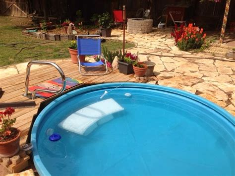 stock tank pool wanna stay cool diy a stock tank pool the budget decorator