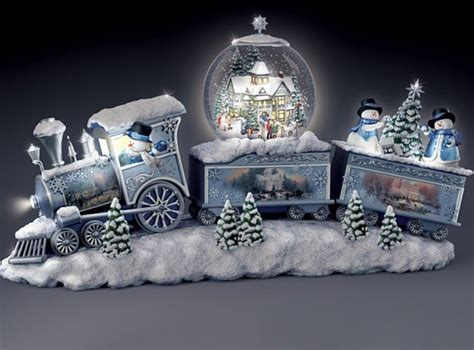 thomas the train follow the light snowfall express light up musical snowman snowglobe train