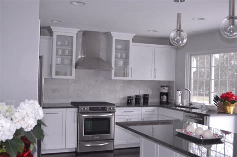 White And Grey Countertops by White Kitchen Cabinets With Gray Granite Countertops Grey