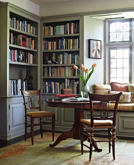 cozy reading nook with built in corner bookcases