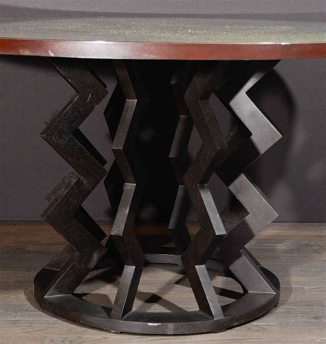 spectacular sculpted bronze shattered glass dining table