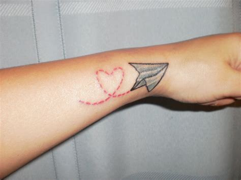 paper airplane tattoo meaning 29 attractive aeroplane wrist tattoos