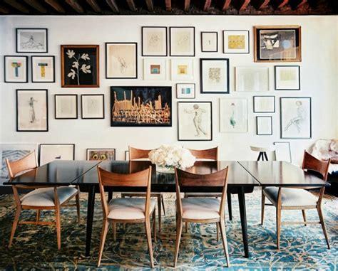 home inspirations muur vol fotolijstjes