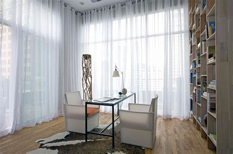 office drapes sheers hung from wall to wall give this home office a soft