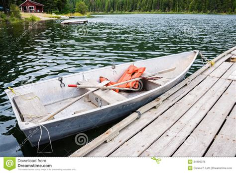 a row boat uses oars boat at dock in lake royalty free stock image image