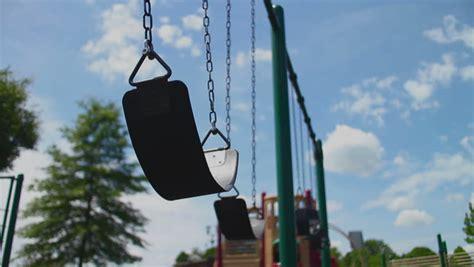 swing wind empty swing set blowing in the wind stock footage video