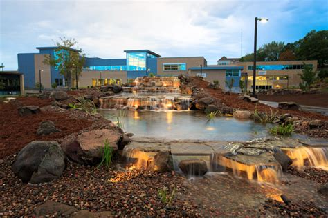 Uw Point Mba by Shimmering Water Feature Rises Above Mall