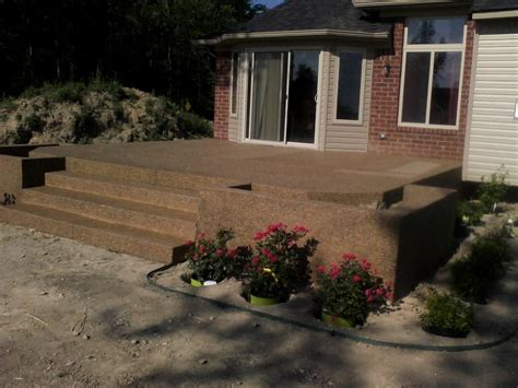 Raised exposed aggregate patio with custom step entrance