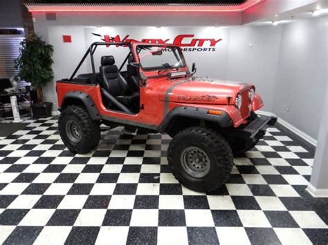 1991 jeep wrangler 4x4 4 0 5 speed roll cage custom paint lift kit much more classic jeep