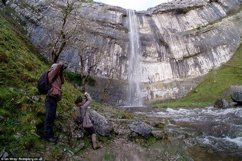 malham cove waterfall starts  flow   storm