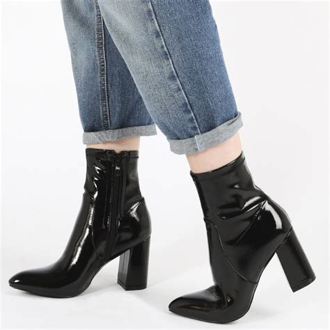raya pointed toe ankle boots in black patent desire