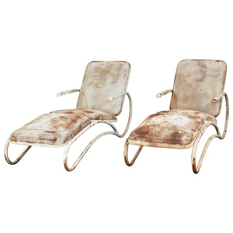 chaises lounges pair of sculptural iron chaise lounges at 1stdibs