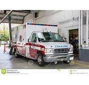 Paramedic Ambulance Inside Firefighter Station Stock Photo