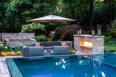 swimming pool landscaping ideas vanishing edge pool patio fireplace modern pool new