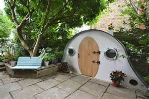 hobbit house garden shed appears to be crafted by mythical