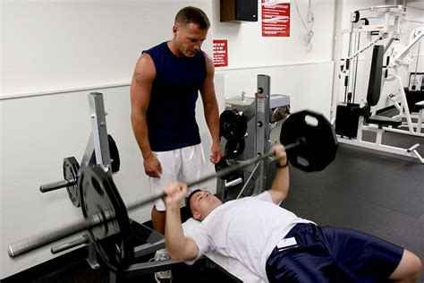 how to bench press a person bench press wikipedia