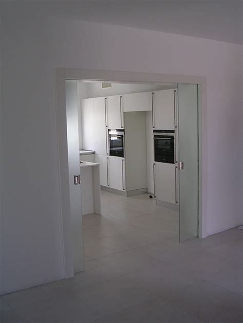 vetro doppia porta doppia scorrevole tuttovetro realizzazione