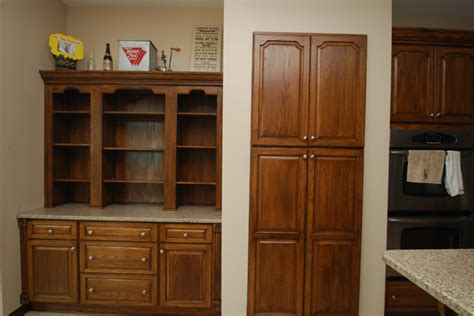 walnut stained cabinets traditional kitchen