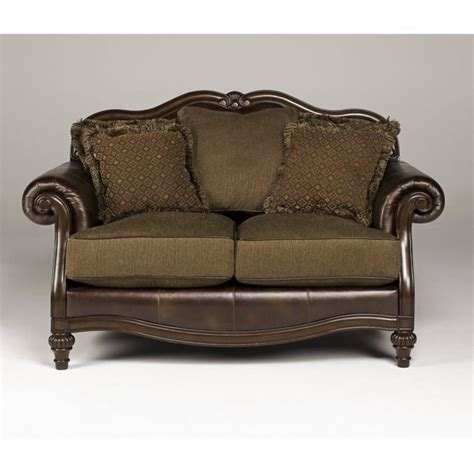antique leather loveseat ashley claremore faux leather loveseat in antique 8430335