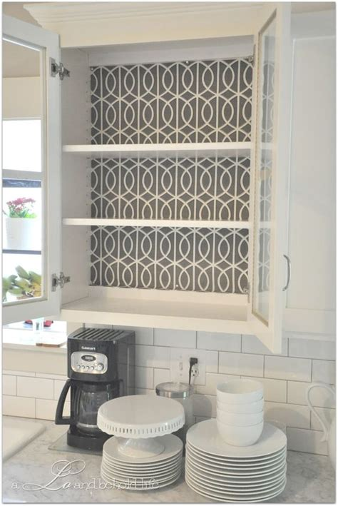 shelf paper for kitchen cabinets use fabric for the backing of shelves instead of paint or
