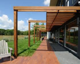 Inspiration for a modern patio remodel in minneapolis with a pergola