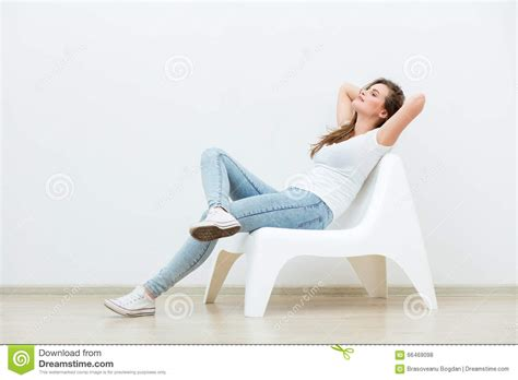 White Sitting Chair by Single Sitting On White Chair Stock Photo Image