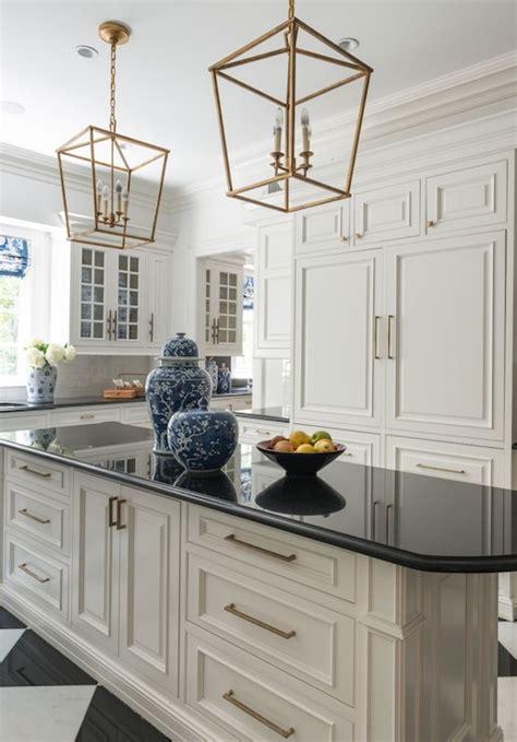 white kitchen cabinets with brass hardware and black darlana small lantern design ideas