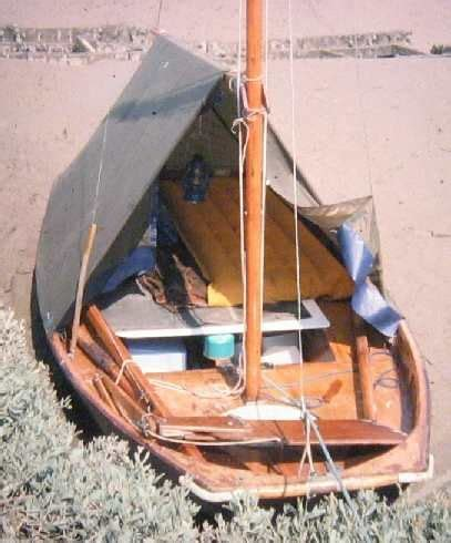 mirror dinghy outfitted  beach cruising boom tents