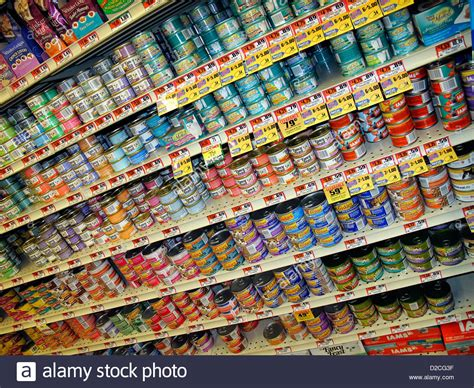 What Store Sells On The Shelf by Variety Of Canned Cat Food Products On A Store Shelf Stock