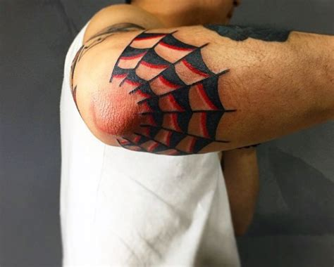 new school elbow tattoo red and black ink half of spiderweb tattoo on elbow in old
